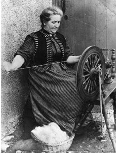 Peter Gray's great grandmother spinning  wool on the Isle of Lewis in the Outer   Hebrides in the late 1800s. Look at how she draws the yarn out in what we would call a long draw. This was a typical spinning style of the time.