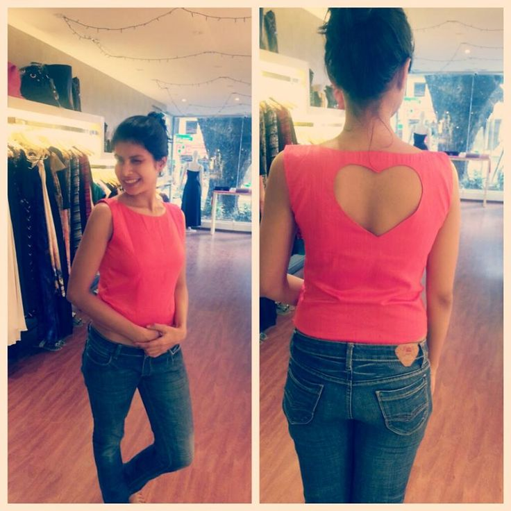 Pink Top with a heart-shaped cut-out on the back.