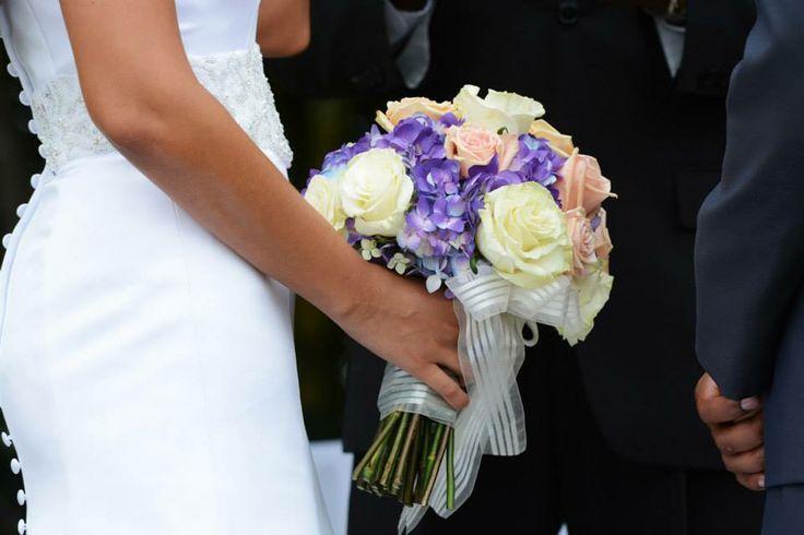 Bridal bouquet: purple hydrangeas, white and peach roses