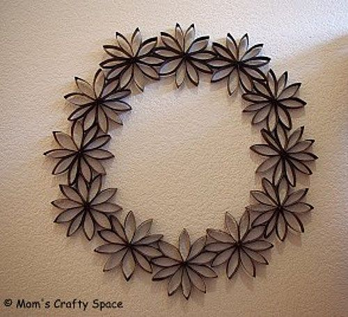 Paper Wreath: This is an amazing way to make use of the toilet paper tubes that keep piling up around the house. Heidi Kundin of the blog Mom's Crafty Space said each wreath took between 12 and 15 toilet paper rolls to make.  She says she started with a piece of cardboard as a template, but once she started making the wreaths, it was really easy. Somehow, I don't think mine would look nearly as pretty!