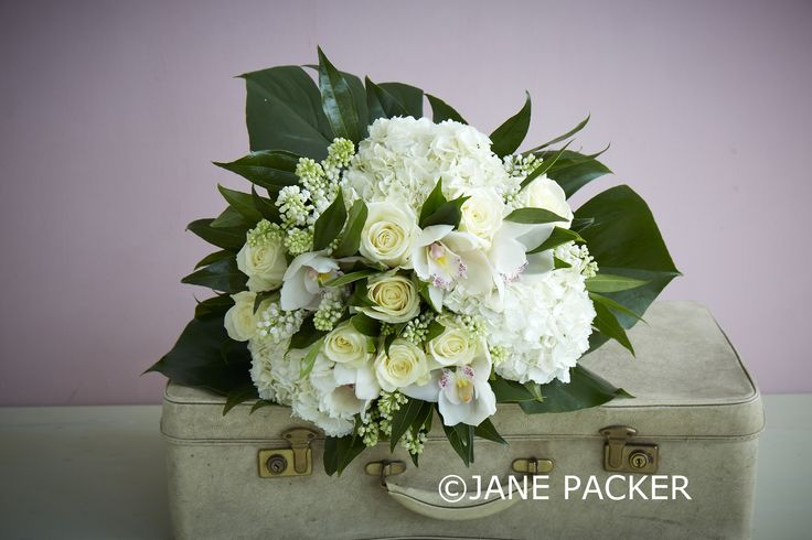 Brilliant white like the sandy beaches of the Seychelles with a touch of exotic greenery. This spectacular bouquet contains a tantalising concoction of bright white Hydrangeas, splendid Avalanche Roses, snowy coloured Lilac, tropical Cymbidium Orchids, and a wealth of waxy and vibrant foliage.