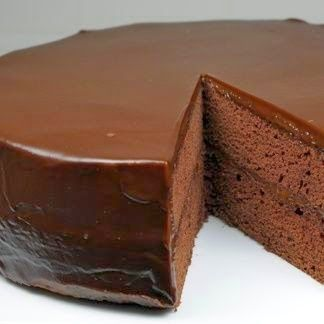 Flourless Chocolate Cake with Chocolate Glaze ~ This moist and dense chocolate cake is topped with a smooth, rich dark chocolate ganache that melts in your mouth. Serve it with sweetened whipped cream and raspberries for a delightful and elegant desert..