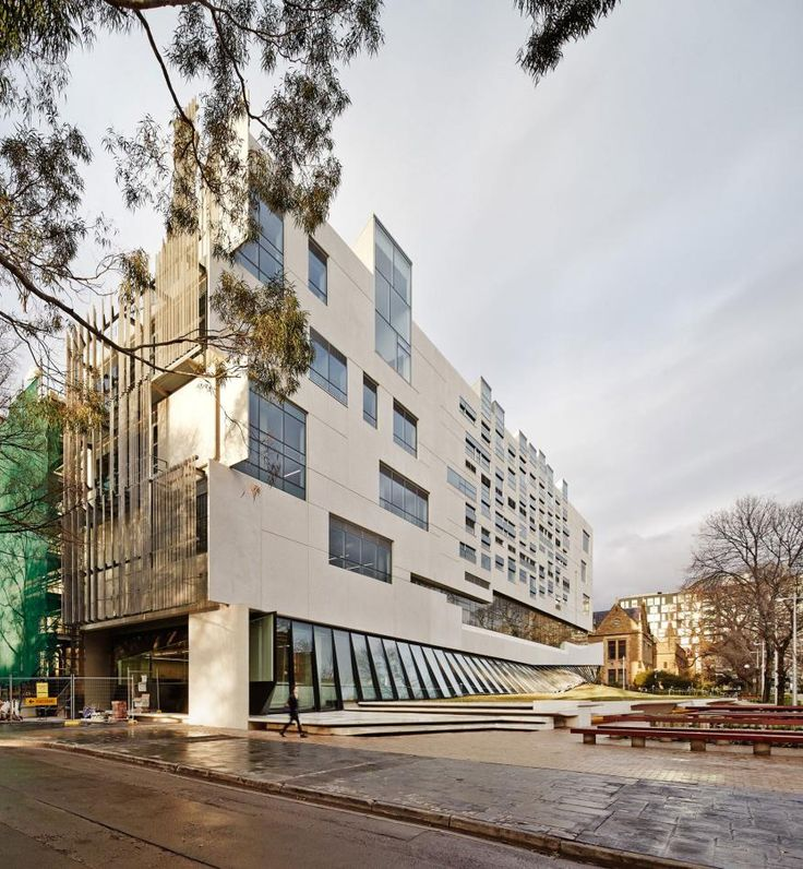 The concrete panels of the south facade are interrupted by windows into the lab and studio spaces.
