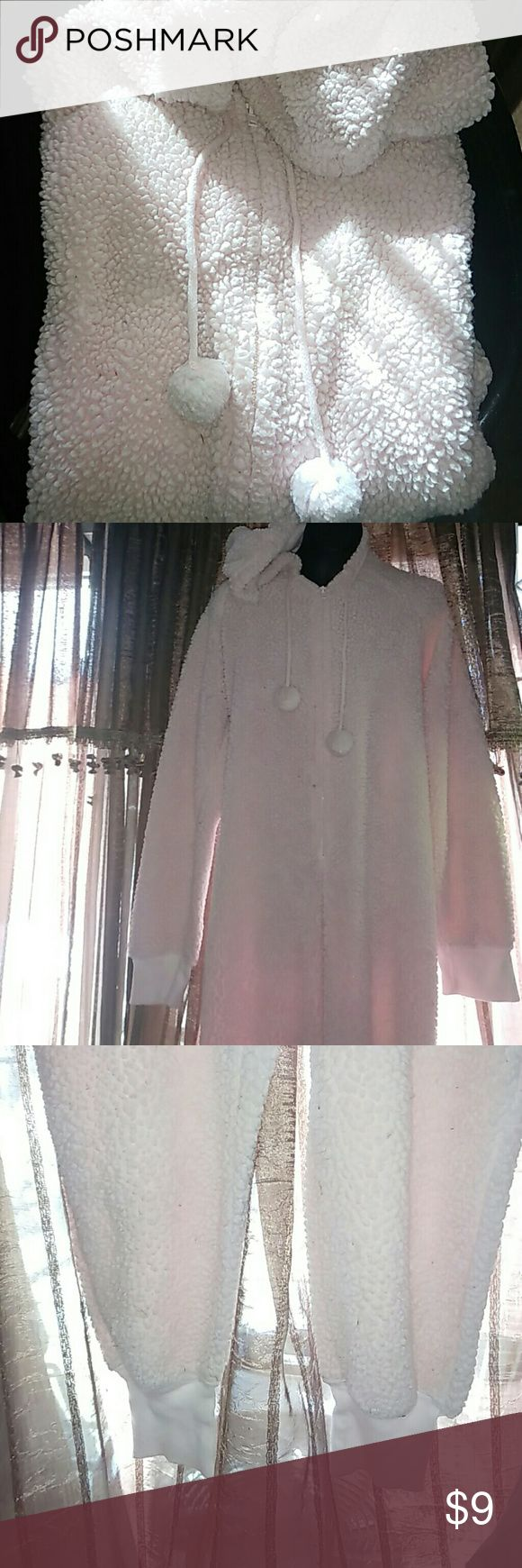 Women's Pink Plush Onesie pjs...medium Women's used one piece pajamas. Thick pale pink colored footless, Zip-up, hooded, onesie style pajamas. They have a drawstring hood with pink puff balls on the ends. There are some spots of blue on the front as seen in 5th photo. I will try to remove before shipping, but buyer be aware that they may not come out. Xhilaration Intimates & Sleepwear Pajamas
