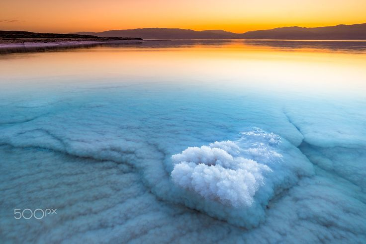 Sunrise at the Dead Sea in Israel. Receding waters continuously reveal salt formations.