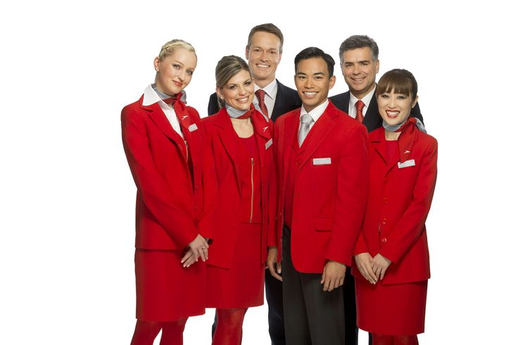 Austrian Airlines attendants dress in red and silver, emblematic of the colors of the Austrian flag.