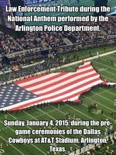 Law Enforcement Tribute during the National Anthem performed by the Arlington Police Department, Sunday, January 4, 2015, during the pre-game ceremonies of the Dallas Cowboys at AT&T Stadium, Arlington, Texas.