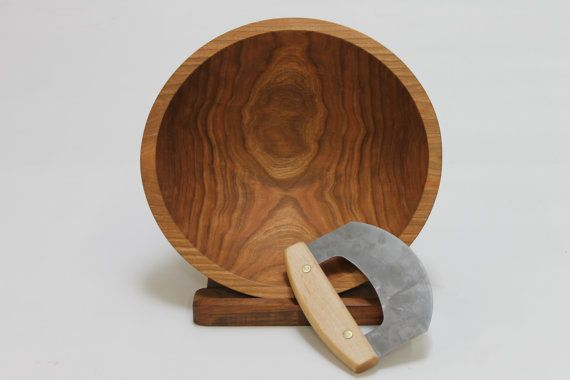 This beautiful solid Cherry bowl was turned by the craftsmen at the Holland Bowl Mill, which is one of the last commercial wooden bowl mills in the United States. Bees Oil finished chopping bowl set comes with a 12-inch Cherry Chopping Bowl and Maple Mezzaluna Knife. The set is great for chopping garlic, herbs and vegetables. The bowl makes chopping much easier and neater than using a full sized cutting board. Many people have requested a chopping bowl set from us, and we are glad to be able…