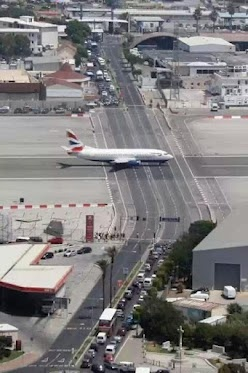 Gibraltar International Airport is the only airport where the runway actually intersects the express highway between Spain and Island. When a plane has to take off or Land, traffic is shut down. More interesting is that the British Airways has daily flights here.The Roads, Gibraltar Airports, Airplanes, British, Runway, Crosses, Places, Winston Churchill, Spain