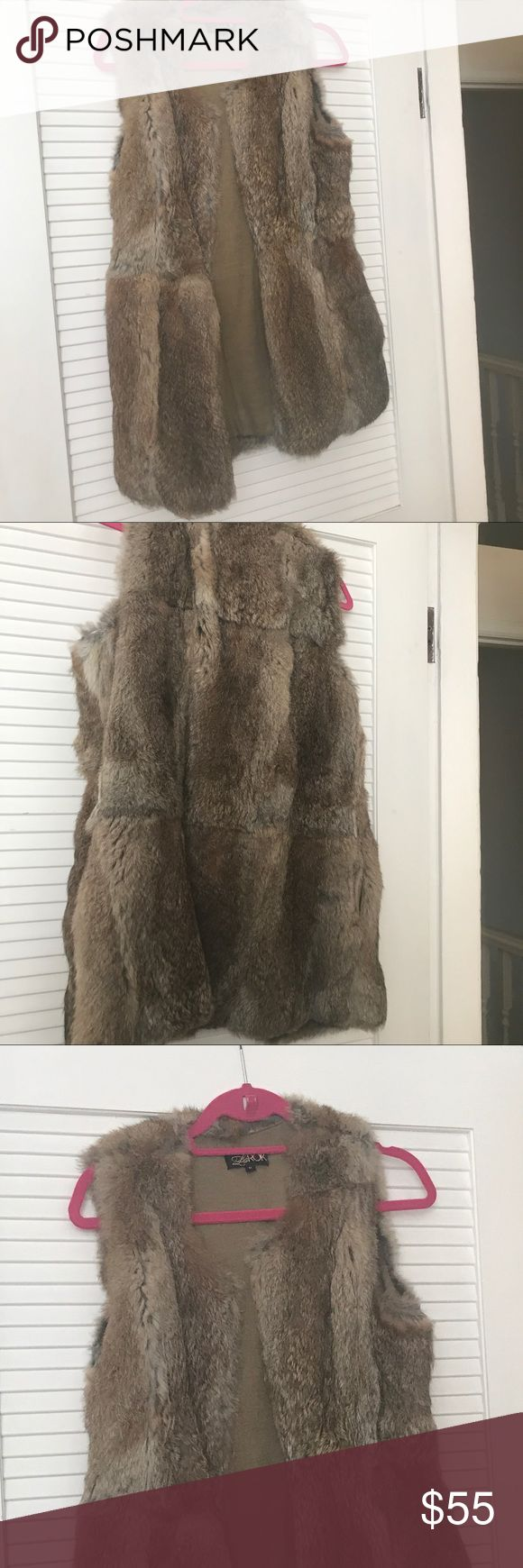 100% rabbit fur vest 100% rabbit fur vest. In perfect condition. Lined. Has side pockets and one central clip at front to keep it closed if you want. la rok Jackets & Coats Vests