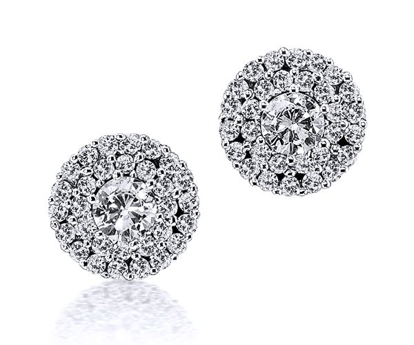 Double Halo stud earrings in 18kt white gold featuring two brilliant-cut diamonds (2.75mm; 0.16ct) encompassed by a total of 60 brilliants (0.14ct tw). • Authentic precious gemstones • Sophisticated design • The highest-quality at the right price