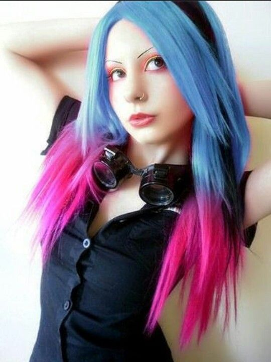 Light navy blue colored hair with hot pink tips and a ...
