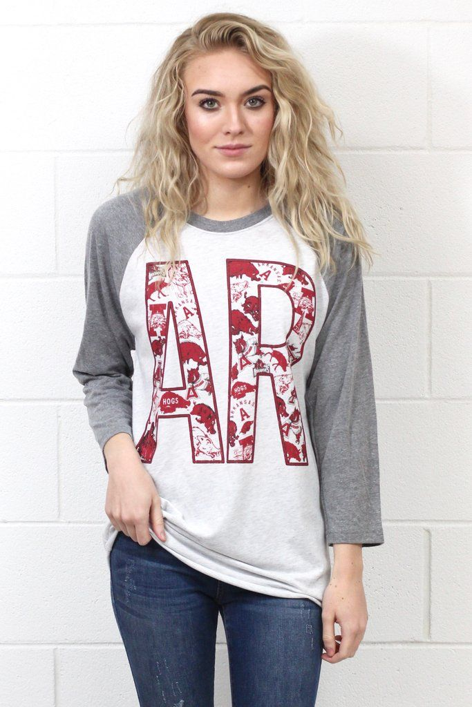 """Call those Hogs in the cutest vintage Arkansas Razorback logo print that is inside the """"AR"""" on this long sleeve raglan top! Light heather grey body with heather grey sleeves. Very comfy fit."""