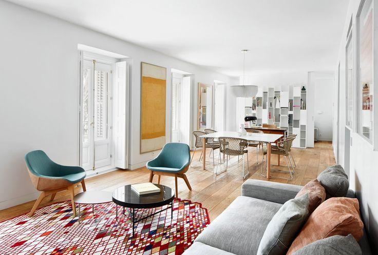 Lucas y Hernández-Gil has overhauled this Madrid apartment, reconfiguring its internal spaces and finishing them with slick oak and marble surfaces.