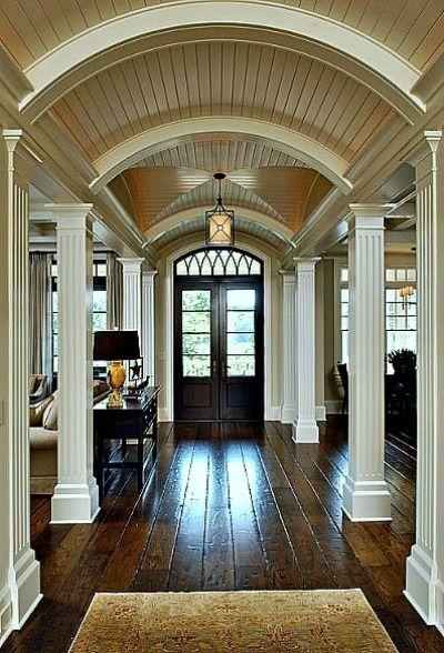 Barrel ceiling, hardwood floors.  Just love the way the columns allow a very open floor plan.