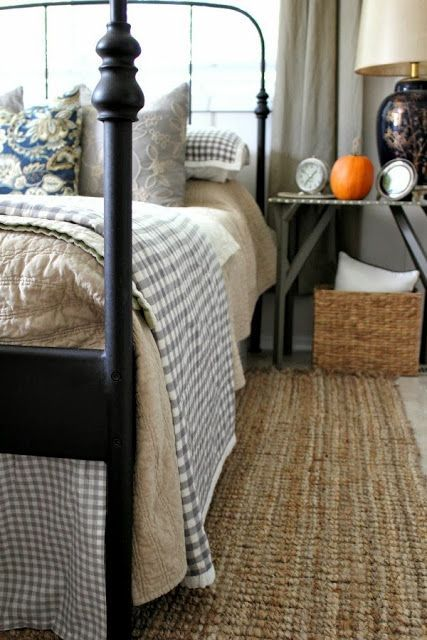 I love this bedroom with the checked bedding and sea grass rug paired together!