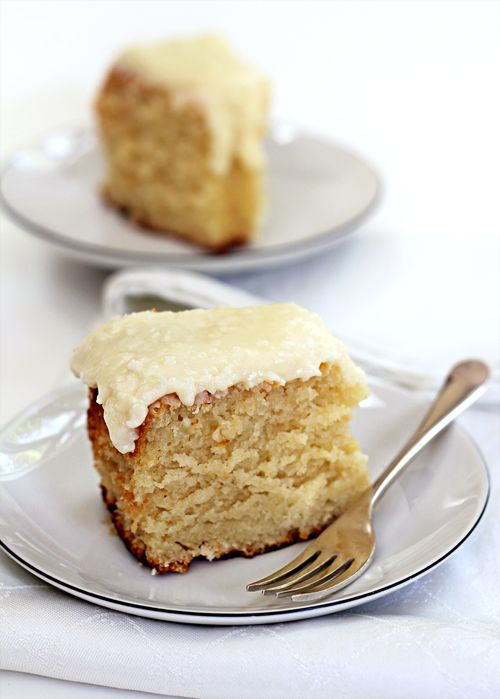 "Lemon Yogurt Cake with Coconut Frosting ~ via this blog, ""Emily Loves Food""."