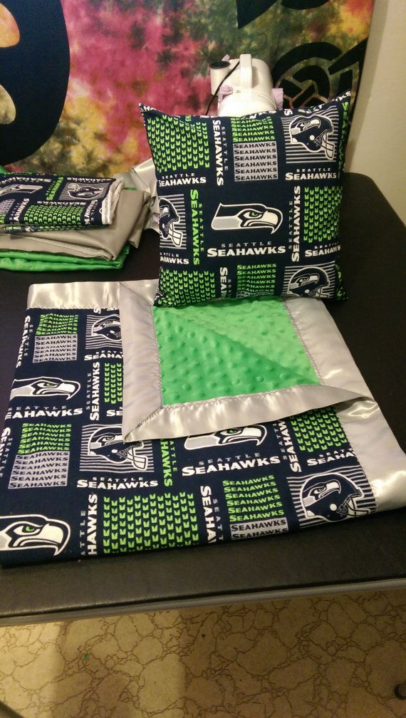 Homemade minky Seahawks baby blanket and pillow giftset. This set features a blanket with a super soft green minky dot backing, licensed NFL Seahawks