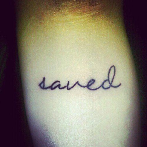 saved by Jesus tattoo