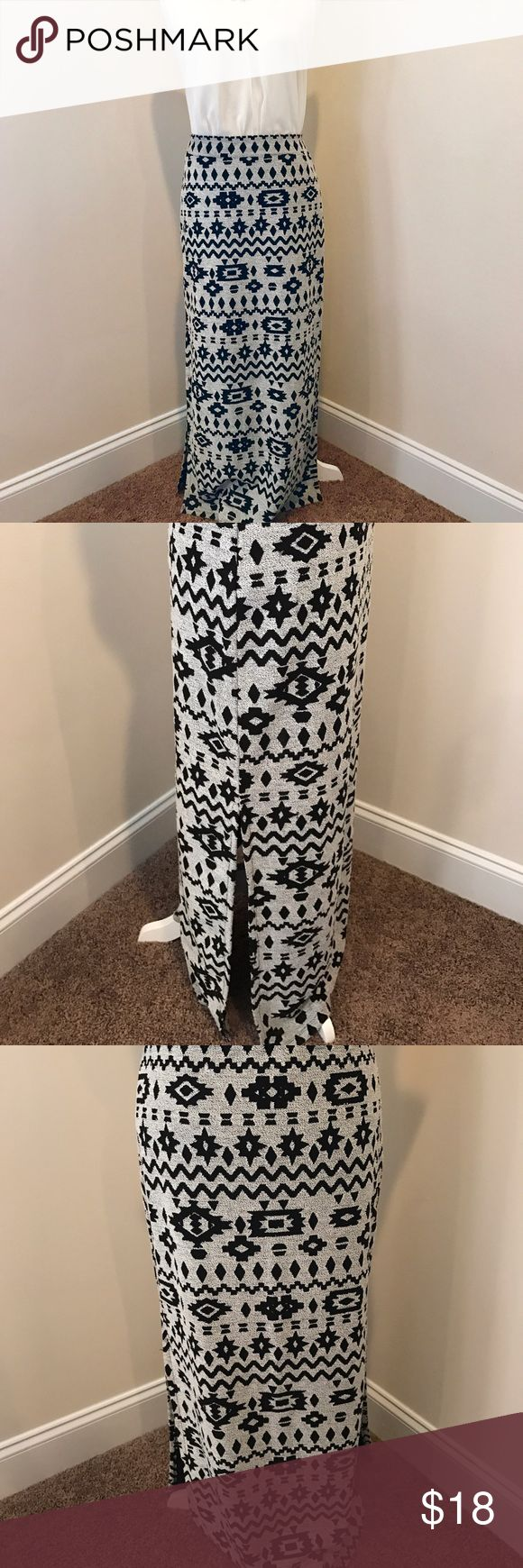 🛍 grey / black fitted Aztec maxi skirt Gorgeous fitted maxi skirt with a peppered grey base color and black Aztec pattern. The skirt is slitted at the bottom 1/4th for a fun and flirty eye-catching pop of texture.                                                🎀                                                                                   Previously loved, but in great condition 💕 Kiss & Cry Skirts Maxi