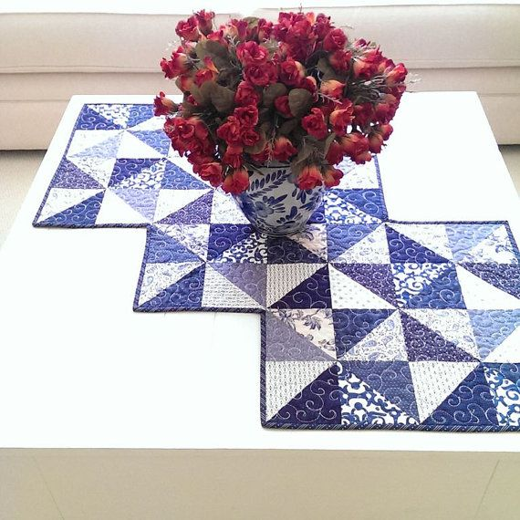 *Rhapsody Whirl* PDF pattern    This beautiful table runner quilt pattern is in PDF. It was designed by myself for Maple Cottage Designs