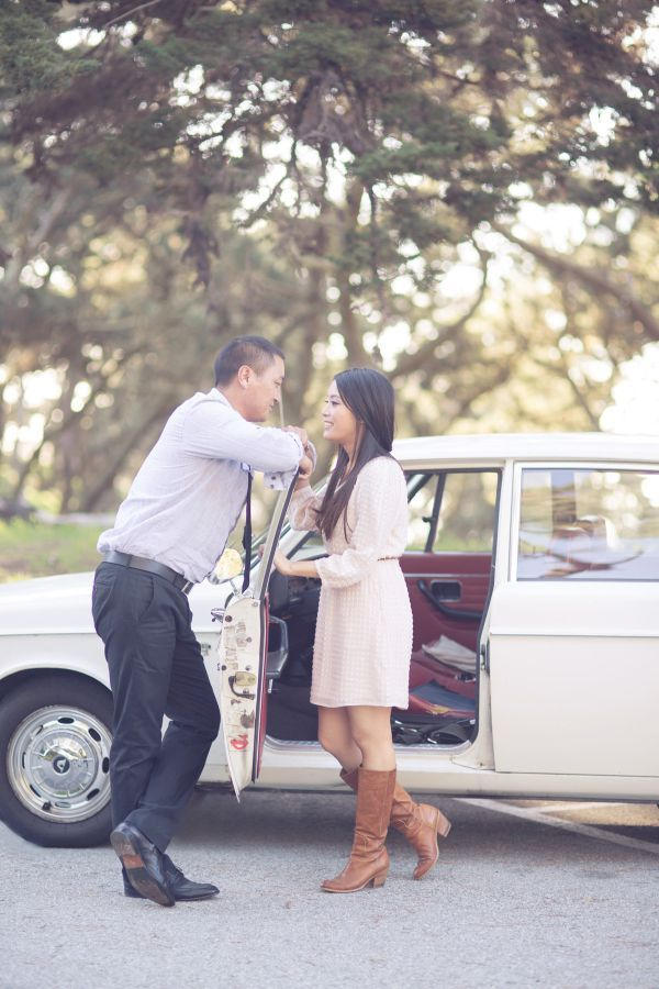 yellow dress engagement pos ith cars
