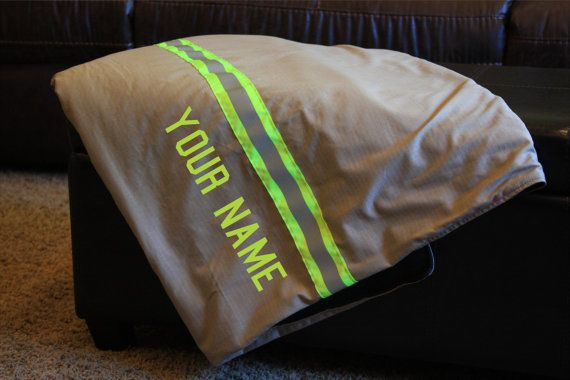 ******* Item is made and ready to ship *******  BLANKET INCLUDES A RED FLEECE BACKING  This blanket is made from new materials that look like real firefighter turnouts/bunker gear. It is made with a cotton poly ripstop material and lime yellow triple trim