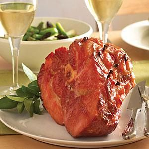 Ham is the centerpiece of any Easter meal; it's quick to prepare and easily serves a crowd. A simple maple-mustard glaze delivers the sweetness of traditional pineapple rings and maraschino cherries, but adds a layer of spice. Prep and Cook Time: 2 1/2 hours. Notes: You can heat the ham ahead, then keep it warm in a low oven. Save the bone for split-pea soup.