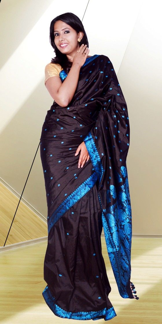 Beautiful Black Assam Silk Pat Suta Saree with first line from anchal is covered with big buta and rest with small buta giving a dazzling look to the Saree. This Pure Assam silk Saree is perfect for any festive occasion.The Saree comes with matching blouse piece, the blouse shown in the image is just for display purpose.