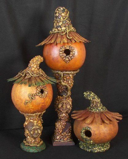 Super cute, pumpkin birdhouses.  Has a witchy-fairy look, rather than the straight-up black warty scary witch look.