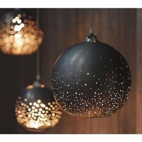 Lamps gold black - *Insppiration* papier mache black orbs with pin holes throughout and little electric tealights inside.