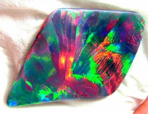 (TBO) OPAL SOLID GEM HARLEQUIN COLLECTOR ITEM  38.80 CTS
