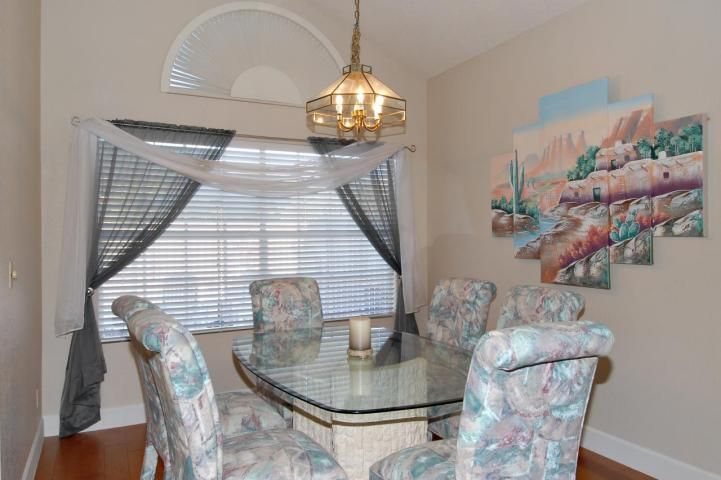 80s décor Southwest artwork pastel color dining chairs brass light Phoenix home house