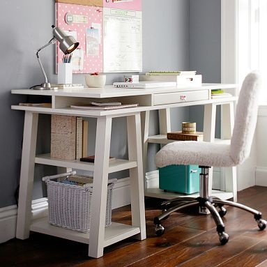 possible desk?  Similar look use 2 Home Depot wooden saw horses and a flat hollow door. Paint it a light soft gray, easy on the eyes when you work. Cost 50$  or less.