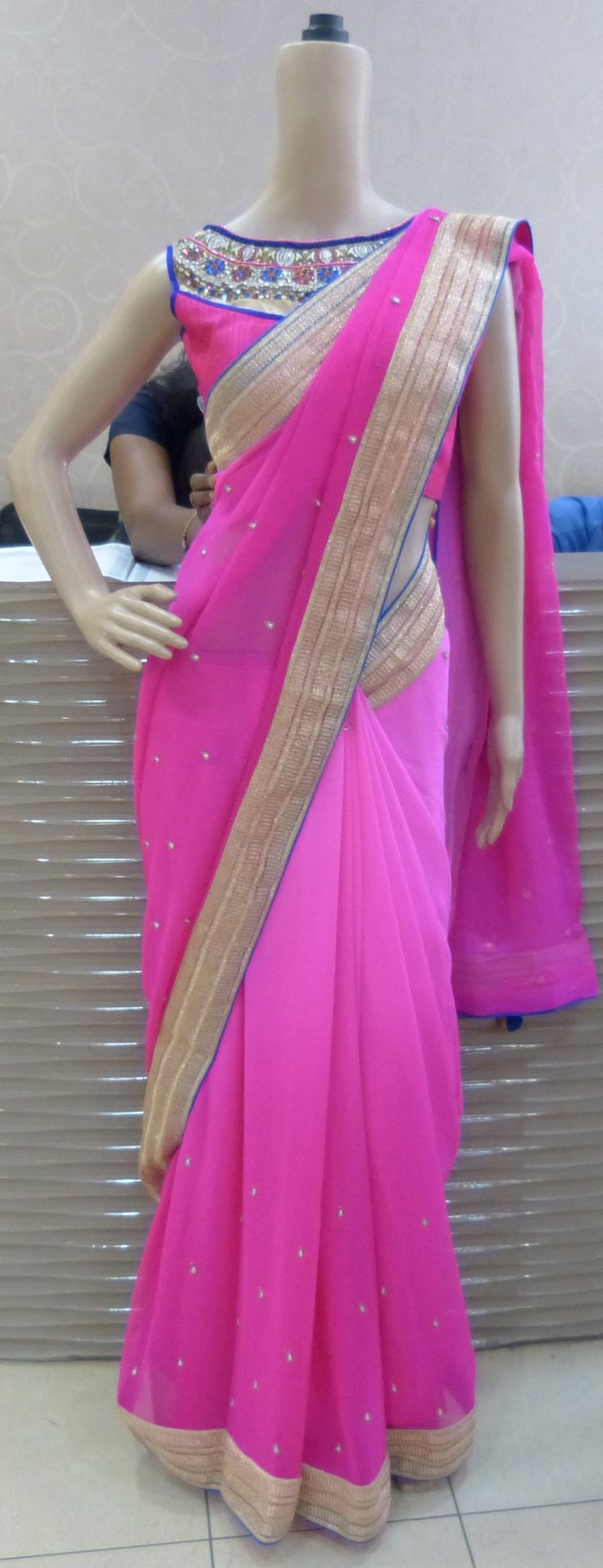 Hot pink chiffon saree with a designer blouse set with crystals and gold embroidery