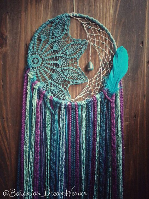 Calling all mermaids! ✊ This mermaid inspired dreamcatcher is gorgeous! It is a 10in hoop webbed in glass beading and a half teal doily. It is adorned with a beautiful stone and feather,and is 34in in length. It is sure to make a statement in any room. PLEASE NOTE!!! The last picture is the stones Im using as I no longer have the original ones. These are gorgeous and I love them even more! **BE INSPIRED! See something you love but want to switch up colors/designs? I LOVE custom orders-mes...