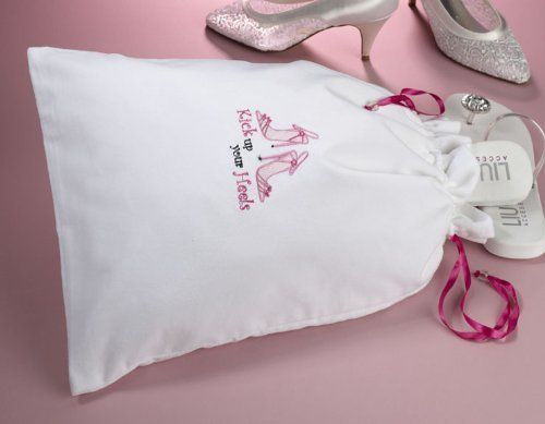"Kick Up Your Heels White Cotton Shoe Bag by Lillian Rose Collection. $12.99. Kick Up Your Heels Shoe Bag. See Full Description Below.. Order Unique All Occasion Favors & Gifts. Measuring 18"" x 12.5"", this white cotton shoe bag is a great way to store your high heels for the trip to the wedding ceremony.  Hot pink satin ribbons help cinch up the top. One side is embroidered with a pair of high heels and the phrase ""Kick up your Heels."""