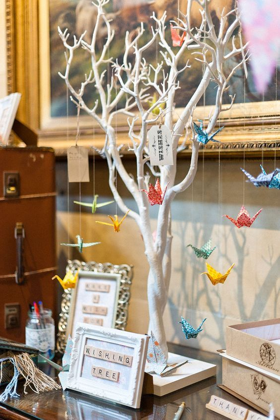 Wishing Tree Alternative Guest Book with hanging origami paper cranes / http://www.himisspuff.com/origami-wedding-ideas/2/