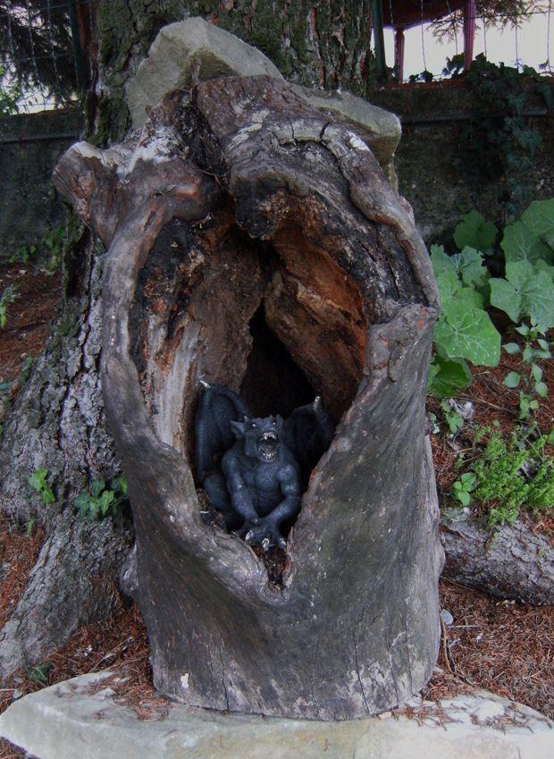 A small dragon guards a treasure hidden in a tree trunk :-)