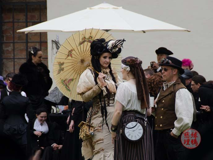 Victorian village and goth costumes at Wave Gotik Treffen in Leipzig, Germany. See photos of industrial bands performing, the Black Market shops at Agra and more on LaCarmina blog: http://www.lacarmina.com/blog/2015/07/wave-gothic-treffen-leipzig-steampunk-boots-goths/  steampunk lady hat, parasol
