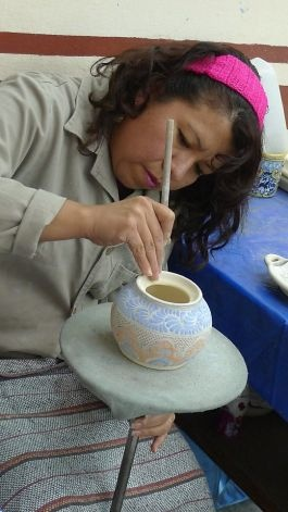 An artist paints pottery at Uriarte Talavera in Puebla, Mexico. Photo: Jill K. Robinson, Special To The Chronicle