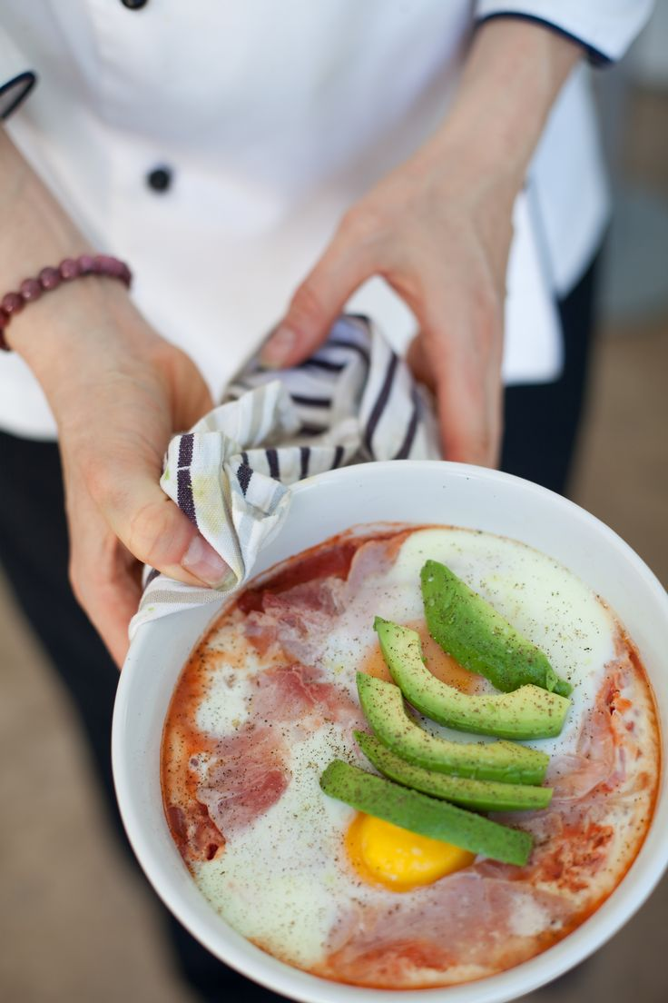 Straight out of the oven.... Baked eggs with Tuscan herbs and shaved leg of ham.  This is a recipe from my book Rocket Fuel on A Budget ..  www.energycoachinginstitute.com Photo by Helen Coetzee