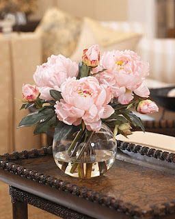 Fake flowers or real ones when it comes to decorating? This site takes the fake flower side with arrangements that appear lifelike!