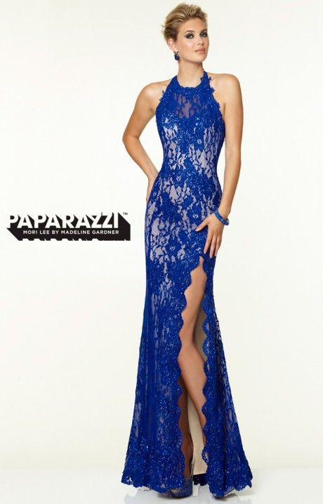 Get glowing in this gorgeous lace gown! Paparazzi 97101 has a high neckline, a beautiful lace bodice, and a stunning lower back. This dress will turn heads at prom, a formal gala, or military ball, especially with that sexy thigh-high slit!