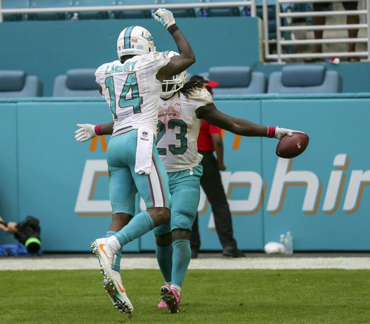 Steelers vs. Dolphins:     October 16, 2016  -  30-15, Dolphins  -      Miami Dolphins wide receiver Jarvis Landry (14), celebrates with Miami Dolphins running back Jay Ajayi (23), after Ajayi, scored a running touchdown with seconds left in the game against the Pittsburgh Steelers during their NFL game Sunday October 15, 2016 at Hard Rock Stadium in Miami Gardens. (Bill Ingram / The Palm Beach Post)