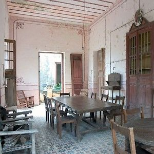 The comedor or diningroom at Hacienda Uayalceh still has furniture left behind when it was abandoned after the Revolution. A caretaker continues to live at the hacienda, but does not eat here. <a href=></a>
