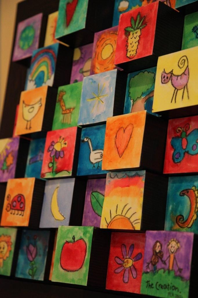 """""""The Creation"""": A 3-D wooden block and water colour art project by children for a school auction. Inspired by: http://www.oliveandlove.com/2011/06/3d-wooden-blocks-childrens-auction-art.html  http://www.oliveandlove.com/2011/06/3d-wooden-blocks-childrens-auction-art.html"""