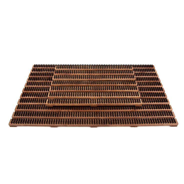 Add traditional Swedish craftsmanship to your home with this brown door mat from Iris Hantverk. Ideal for wiping your shoes on & keeping dirt out of your home it has been made from wood with nylon ...