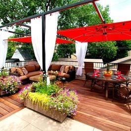 Very clever!  This rooftop patio uses red Shademaker umbrellas as shade cover with mounting brackets and heavy duty sailing pulleys on a steel pergola frame... Add planters with seasonal blooms and lounging area -- heaven on the deck or patio! By Chicago Green Design, Houzz.