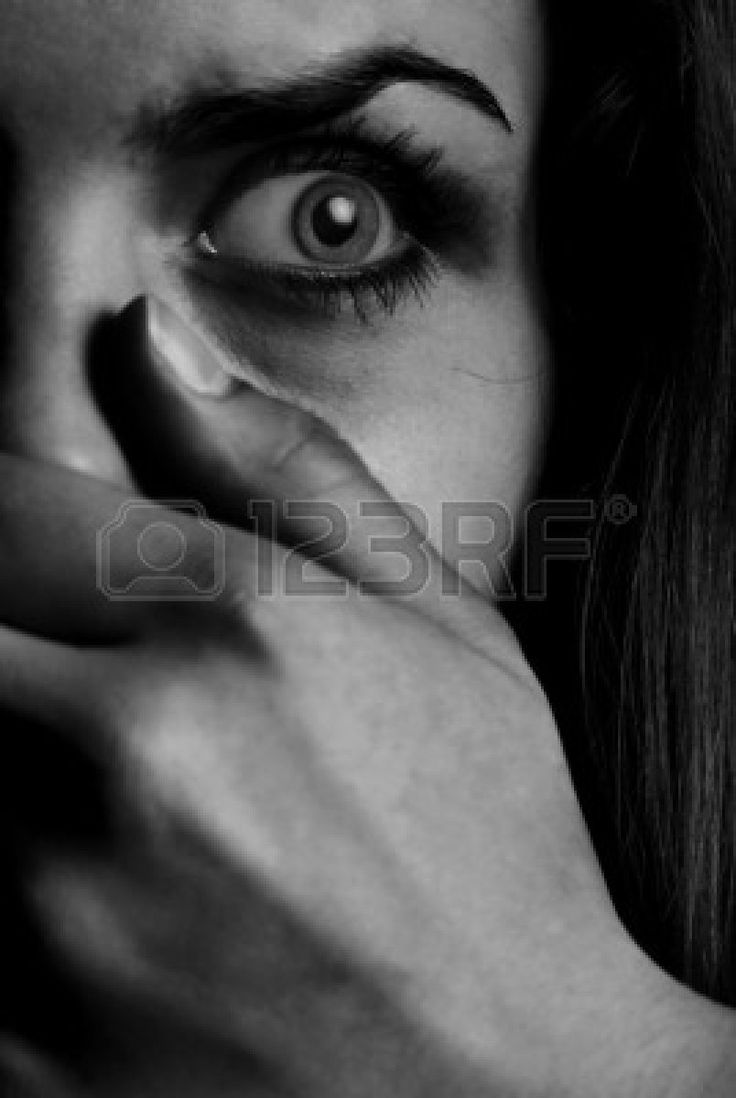 Horror monochrome photo of the afraid woman with mouth covered by hand Stock Photo